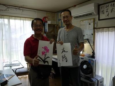 書と墨画の交換会。私が描いたのはピンクの「蘭」。
