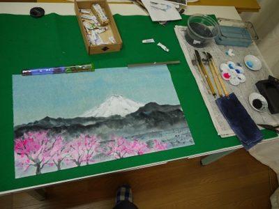 「桜と富士山」を墨と絵具で描いています。